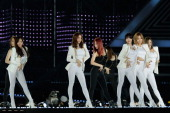 Members of South Korean girl group Dal Shabet perform on stage during the 20th Dream Concert on June 7 2014 in Seoul South Korea