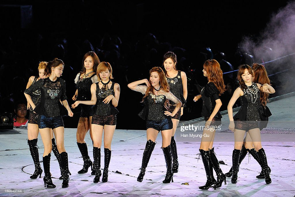 Members of South Korean girl group Girls' Generation perform onstage during the SMTown Live World Tour III on August 18, 2012 in Seoul, South Korea.