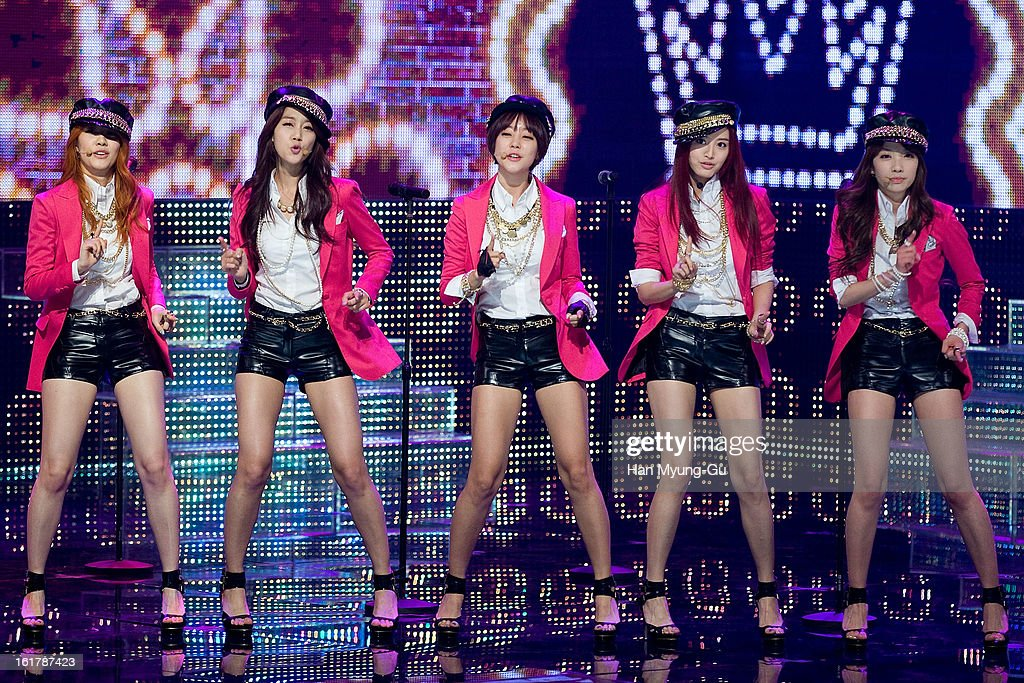 Members of South Korean girl group Rainbow perform onstage during the Mnet 'M CountDown' at CJ E&M Building on February 14, 2013 in Seoul, South Korea.