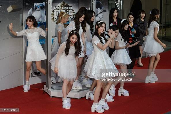 Members of South Korean Kpop group IOI leave after taking a selfie on the red carpet at the Mnet Asian Music Awards at AsiaWorld Expo in Hong Kong on...