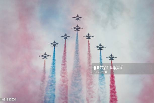 TOPSHOT Members of South Korea's 'Black Eagle' aerobatics team perform a display at the Seoul International Aerospace and Defense Exhibition in...