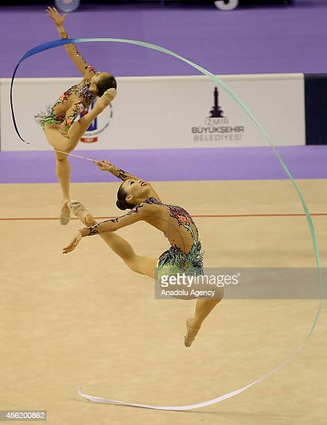 Members of South Korea's rhythmic gymnastics team compete during the 33rd Rhythmic Gymnastics World Championships in Izmir Turkey on September 27 2014