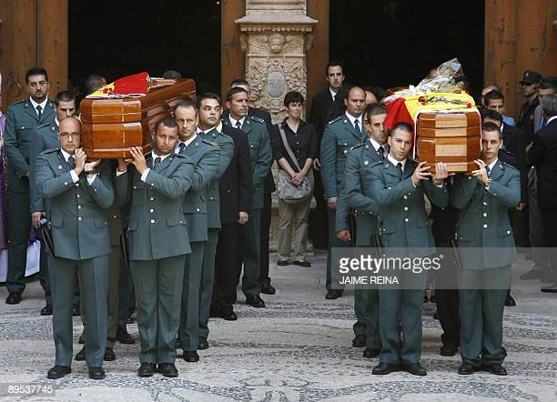Members of Spain's Civil Guards carry the coffin of a colleague killed in a car bomb attack in Palma de Mallorca July 31 2009 Two guards Carlos Saenz...