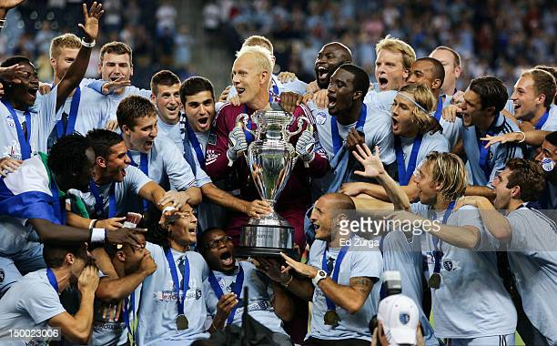 Members of Sporting Kansas City celebrate after defeating the Seattle Sounders FC to win the Lamar Hunt US Open Cup Final at Livestrong Sporting Park...