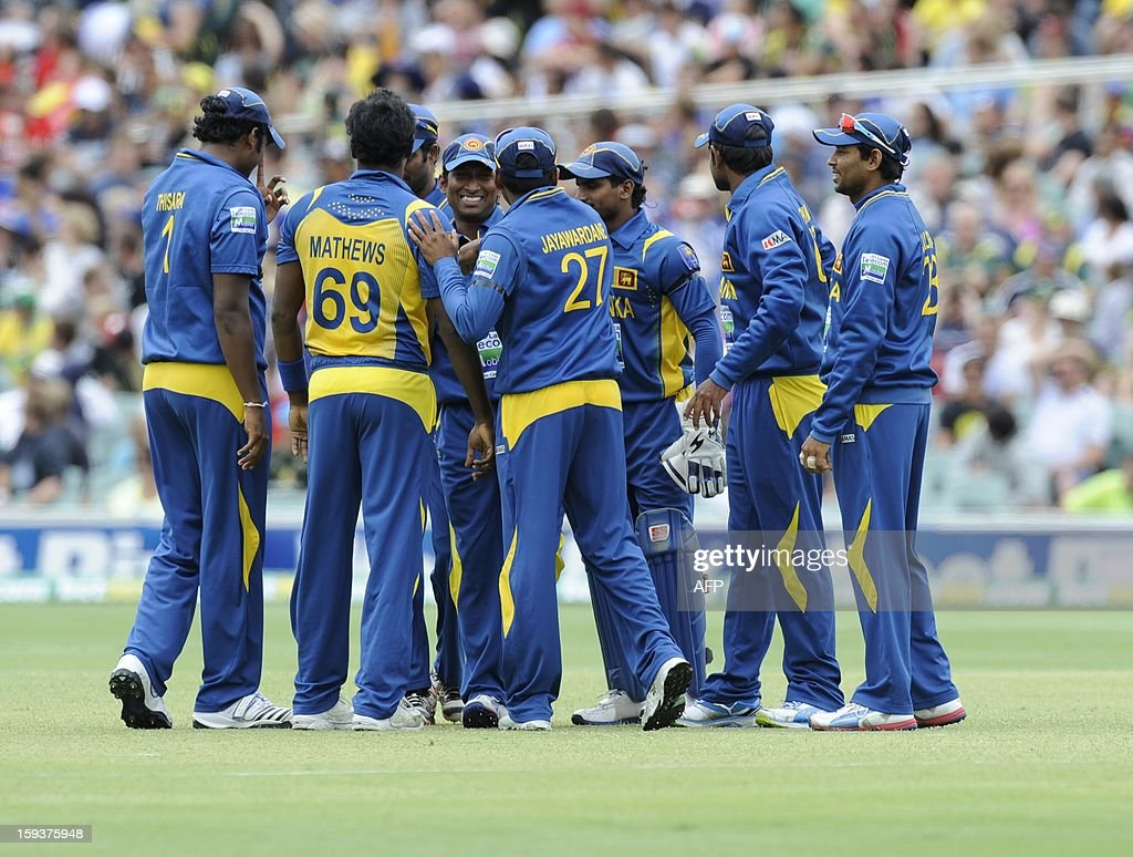 Members of Sri Lanka's team celebrate the dismissal of Australia's batsman Aaron Finch during their one-day international cricket match at the Adelaide Oval on January 13, 2013. AFP PHOTO / David Mariuz USE