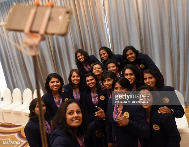 Members of Sri Lanka's women cricket team smile as captain Inoka Ranaweera takes a selfie of the group in Colombo on June 12 ahead of their campaign...
