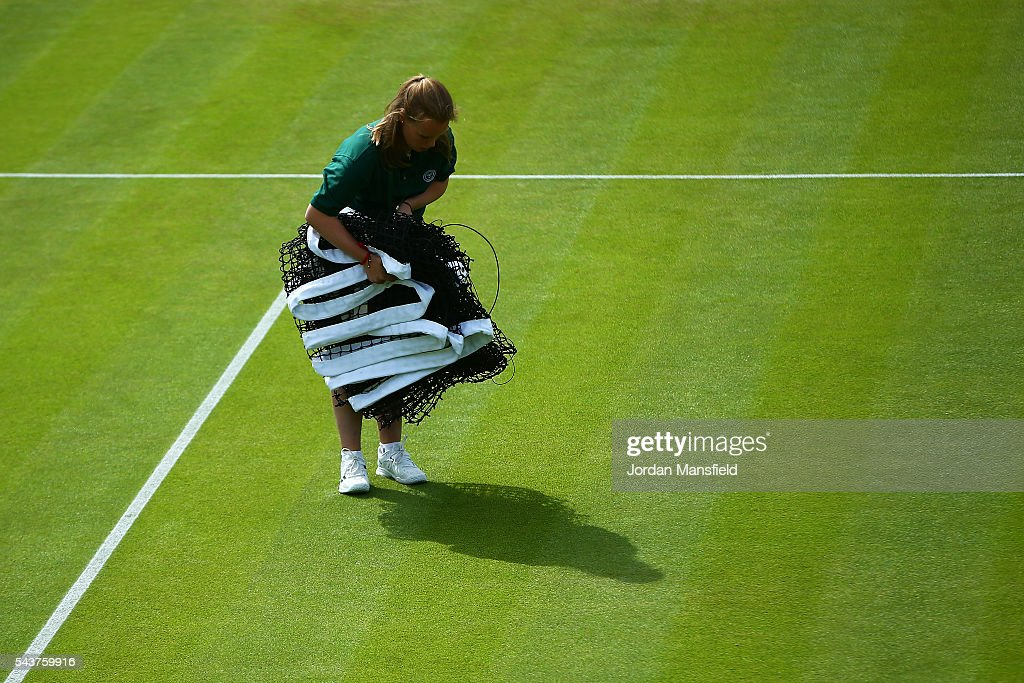 Members of staff pepare the courts on day four of the Wimbledon Lawn Tennis Championships at the All England Lawn Tennis and Croquet Club on June 30, 2016 in London, England.