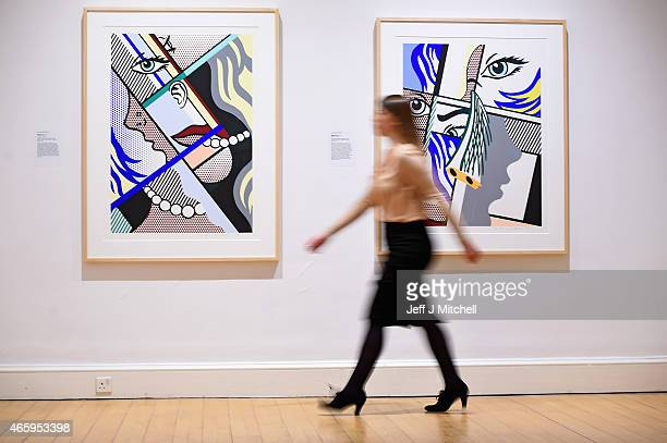 Members of staff view a new exhibition devoted to American Pop artist Roy Lichtenstein which being held at the Scottish National Gallery of Modern...