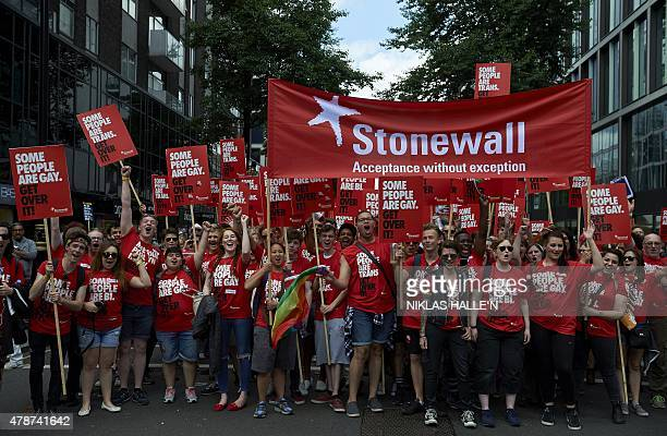 Members of 'Stonewall' who work for equality and justice for lesbians gay men and bisexuals take part in the annual Pride Parade in London on June 27...
