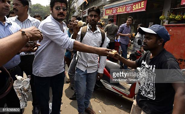 Members of Swabhiman Sanghatana distribute free vada pav to protest against Shiv Sena member Sunil Mahadik on March 1 2016 in Mumbai India Shiv Sena...
