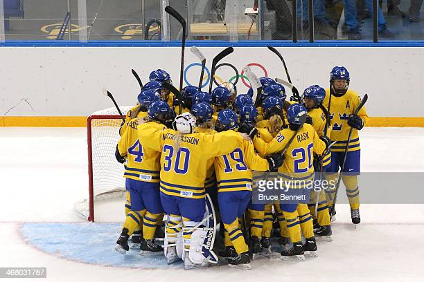 Members of Sweden ice hockey team celebrate their 10 win over Japan during the Women's Ice Hockey Preliminary Round Group B Game on day two of the...