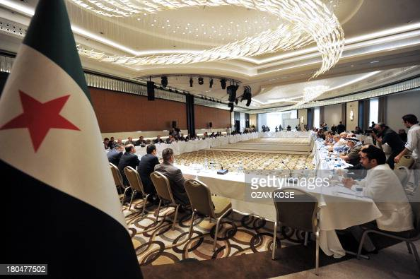 Members of Syrian National coalition attend a meeting of the National Coalition of Syrian Revolution and Opposition forces on September 13 in...