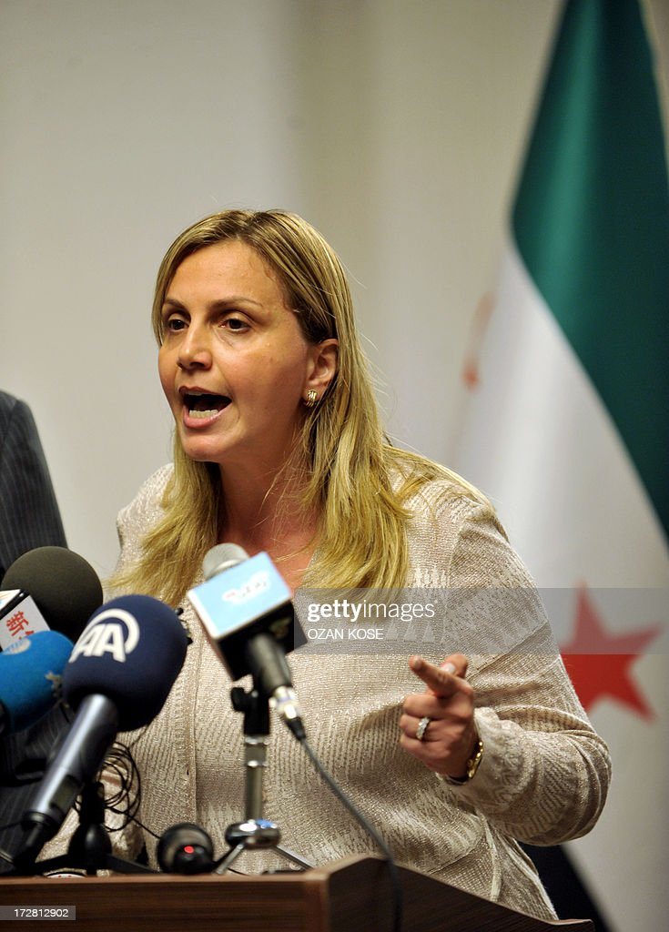Members of Syrian National Coalition (SNC) Farah al Atassi speaks during a press conference, on July 4, 2013 in Istanbul, to announce that Syria's main political opposition will attempt to nominate a new leader to unify a fractured coalition. AFP PHOTO/ OZAN KOSE