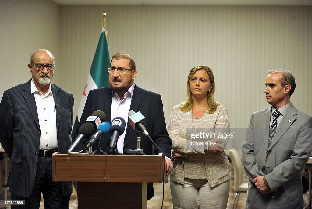 Members of Syrian National Coalition (SNC) Haitham Maleh (L) , Abdul al Karim Bakkar (2ndL) Farah al Atassi (2ndR) and Abdul Rahman Battra (R) give a press conference, on July 4, 2013 in Istanbul, to announce taht Syria's main political opposition will attempt to nominate a new leader to unify a fractured coalition.