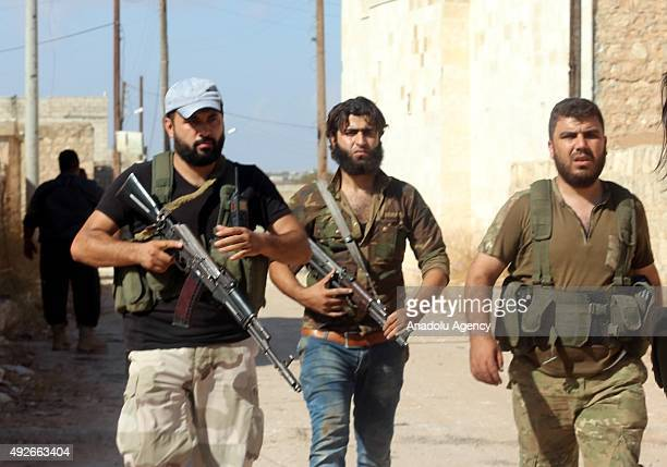 Members of Syrian opposition Fatah forces are seen as they fight against Daesh in Tal Jibbin region in northen Aleppo Syria on October 14 2015