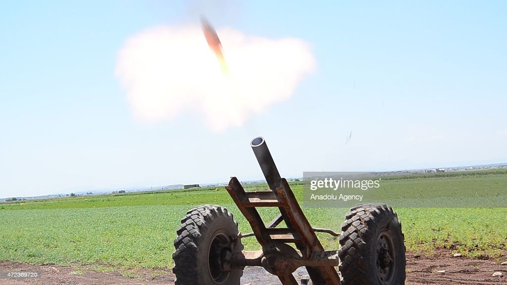 Members of Syrian opposition forces attack with artilleries against Daesh terrorists in the Dabiq Village of the northern Aleppo to seize control...