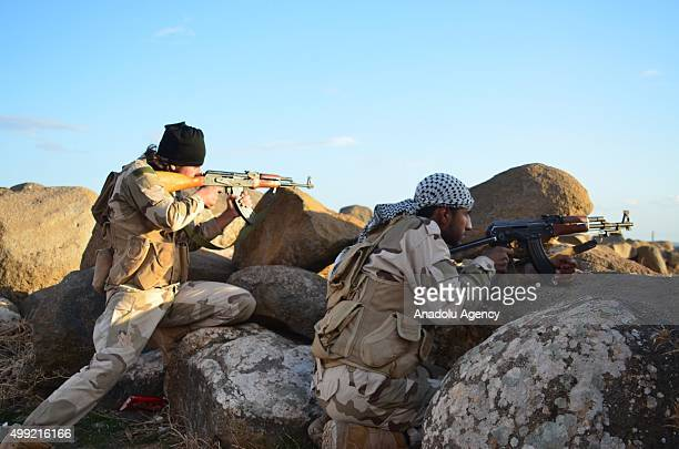 Members of Syrian opposition forces fight against Kurdish rebel group People's Democratic Union in Keshtear village located in Azaz Aleppo on...