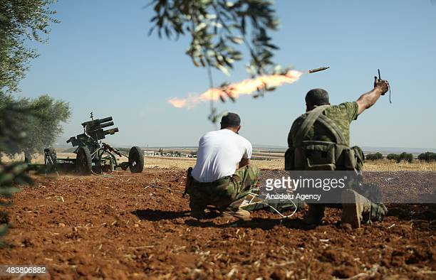 Members of Syrian opposition group linked to Damascus Front launch a rocket towards Daesh militants in the northern countryside of Aleppo Syria on...
