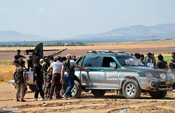 Members of Syrian opposition group linked to Damascus Front make preparations before they launch attacks with heavy weapons on Daesh targets around...