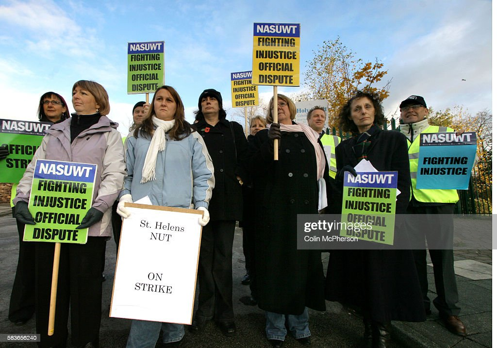 Members of teaching staff of Holy Spirit RC primary school in St Helens Merseyside on an official picket line outside their school on a day of strike...