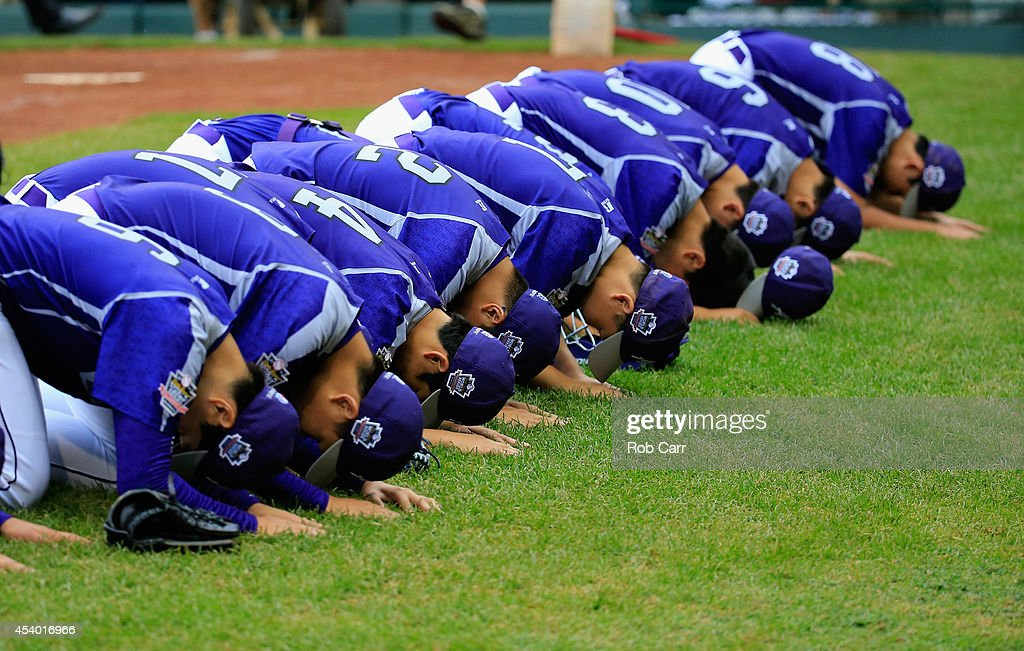 Members of Team Asia-Pacific bow to fans after defeating Team Japan 12-3 during the International Championship game of the Little League World Series at Lamade Stadium on August 23, 2014 in South Williamsport, Pennsylvania.