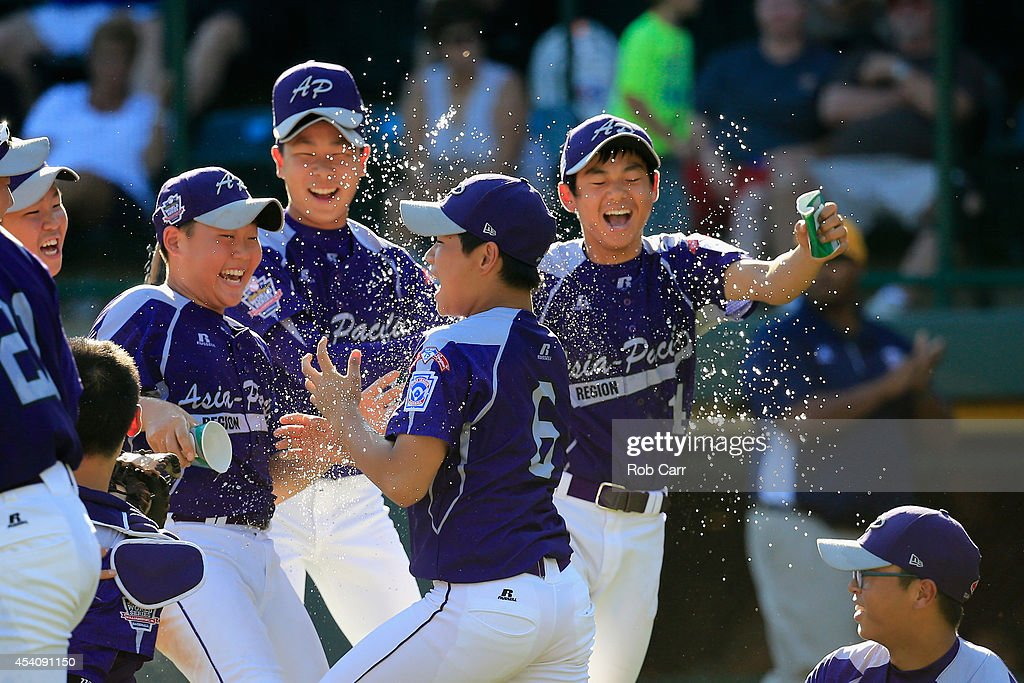 Members of Team Asia-Pacific (L) celebrate following their 8-4 win over the Great Lakes Team from Chicago, Illinois to win the Little League World Series Championship game at Lamade Stadium on August 24, 2014 in South Williamsport, Pennsylvania.