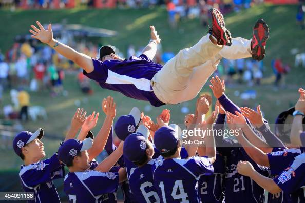 Members of Team AsiaPacific throw an assistant coach in the air following their 84 win over the Great Lakes Team from Chicago Illinois to win the...