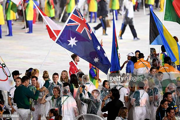 Members of Team Australia walk during the 'Heroes of the Games' segment during the Closing Ceremony on Day 16 of the Rio 2016 Olympic Games at...