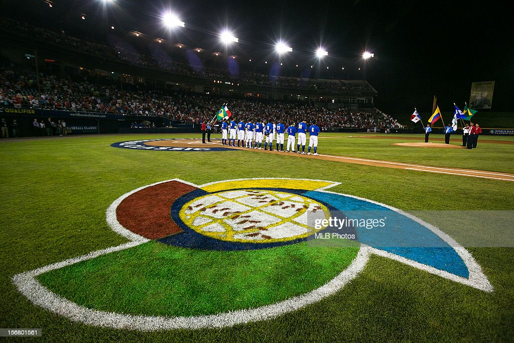 Members of Team Brazil are seen on the base path during the playing of the national anthems before Game 6 of the Qualifying Round of the World Baseball Classic against Team Panama on Monday, November 19, 2012 in Panama City, Panama.