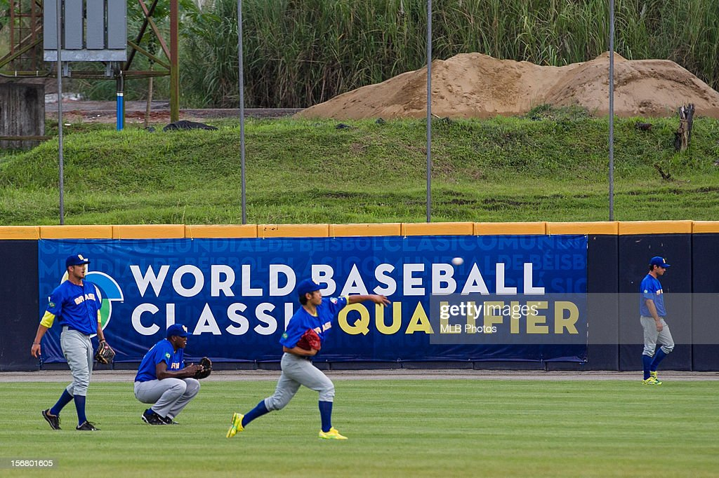 Members of Team Brazil loosen up in the outfield before Game 6 of the Qualifying Round of the World Baseball Classic against Team Panama at Rod Carew National Stadium on Monday, November 19, 2012 in Panama City, Panama.