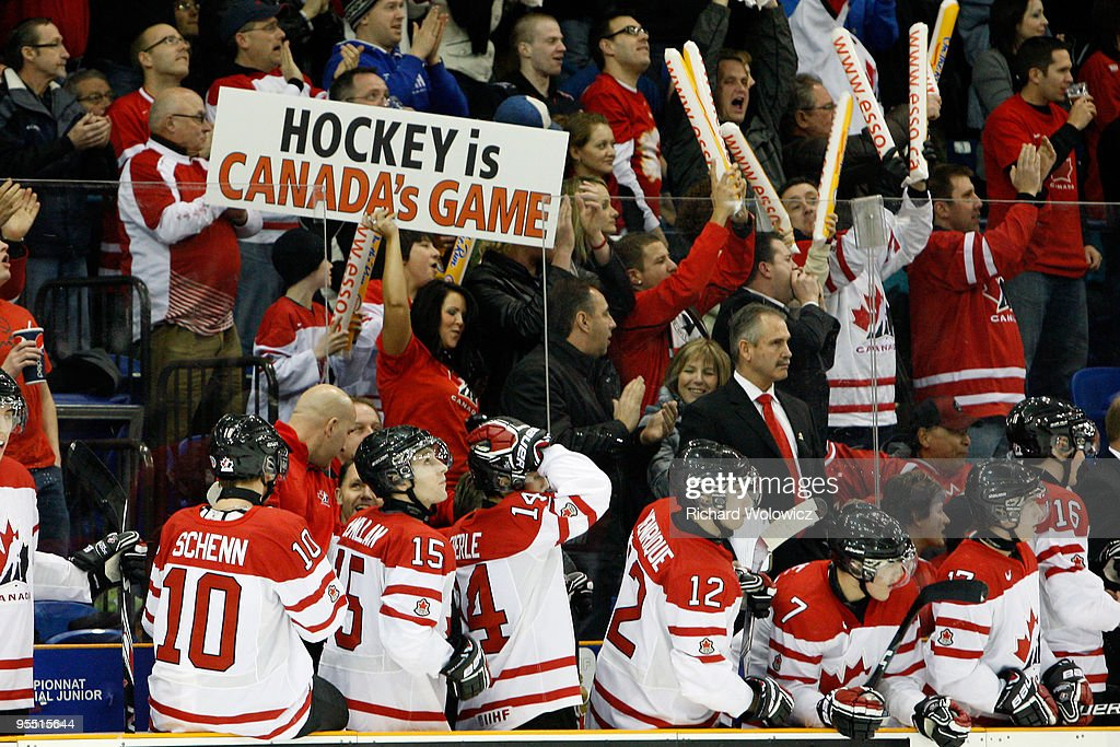 Members of Team Canada and fans celebrate the first period goal by Stefan Della-Rovere #19 of Team Canada during the 2010 IIHF World Junior Championship Tournament game against Team USA on December 31, 2009 at the Credit Union Centre in Saskatoon, Saskatchewan, Canada.