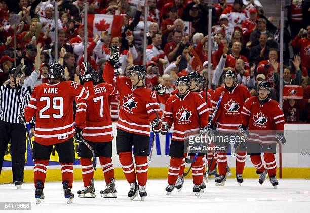 Members of Team Canada celebrate after they score their 2nd empty net goal to seal their victory over Team Sweden during the 2009 IIHF World Junior...