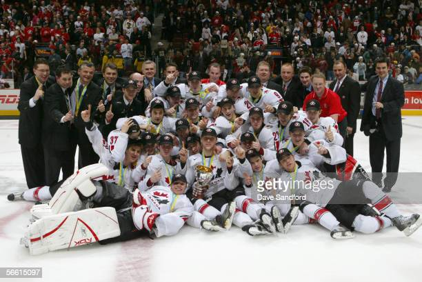 Members of Team Canada celebrate their victory against Team Russia during the gold medal game at the World Junior Hockey Championships at General...