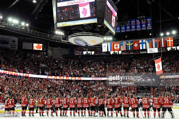 Members of Team Canada during the flag presentation after defeating during the 2012 World Junior Hockey Championship game against Team USA at Rexall...