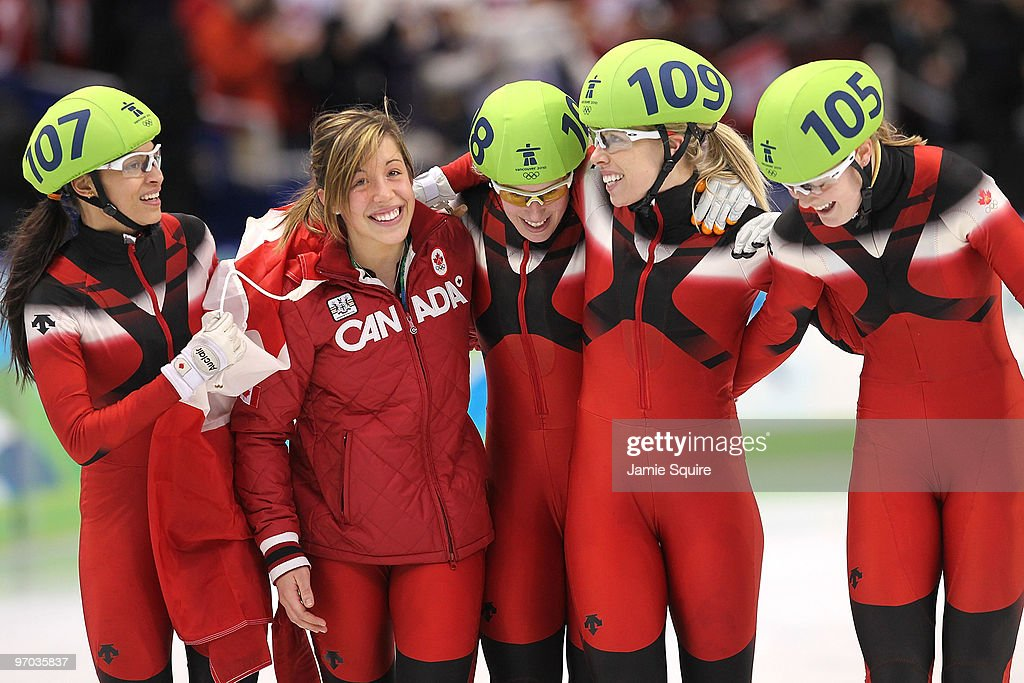 Members of Team Canada Kalyna Roberge unidentified Marianne StGelais Tania Vicent and Jessica Gregg hug after they won the Olympic Silver medal in...