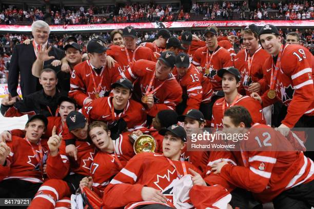 Members of Team Canada pose for a team photo during post game ceremonies after defeating Team Sweden at the Gold Medal Game of the IIHF World Junior...
