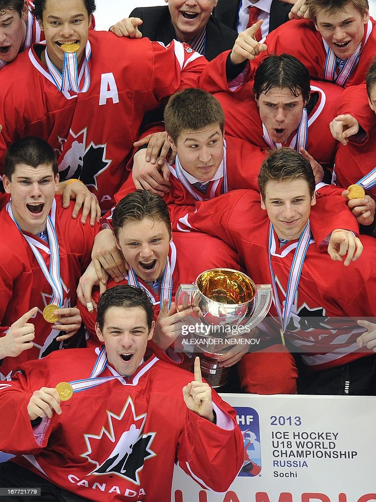 Members of team Canada pose with their trophy and their medals after their 3-2 victiory over team USA during the IIHF U18 International Ice Hockey World Championships final game in Sochi on April 28, 2013.