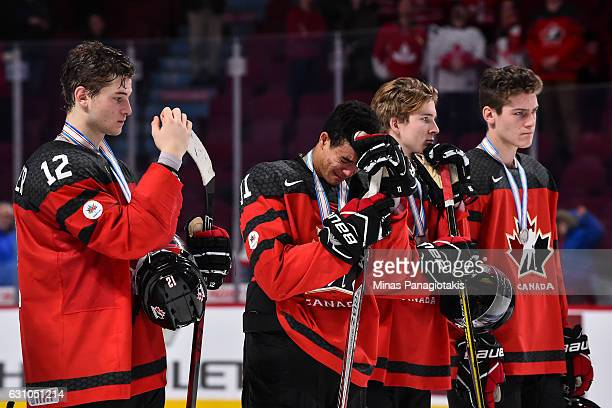 Members of Team Canada react after losing to Team United States during the 2017 IIHF World Junior Championship gold medal game at the Bell Centre on...