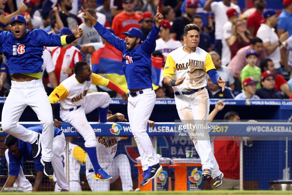 Members of Team Colombia react to a Jorge Alfaro #38 of Team Colombia solo home run in the eighth inning during Game 5 of Pool C of the 2017 World Baseball Classic against Team Dominican Republic on Sunday, March 12, 2017 at Marlins Park in Miami, Florida.