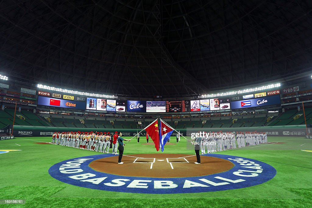 Members of Team Cuba and Team China are seen on the base paths during the playing of the national anthems before Pool A, Game 4 between Team China and Team Cuba during the first round of the 2013 World Baseball Classic at the Fukuoka Yahoo! Japan Dome on Monday, March 4, 2013 in Fukuoka, Japan.