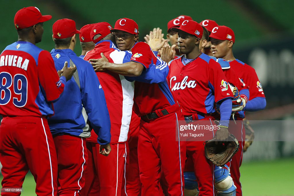 Members of Team Cuba celebrate defeating Team Brazil in Pool A, Game 2 in the first round of the 2013 World Baseball Classic at the Fukuoka Yahoo! Japan Dome on Sunday, March 3, 2013 in Fukuoka, Japan.