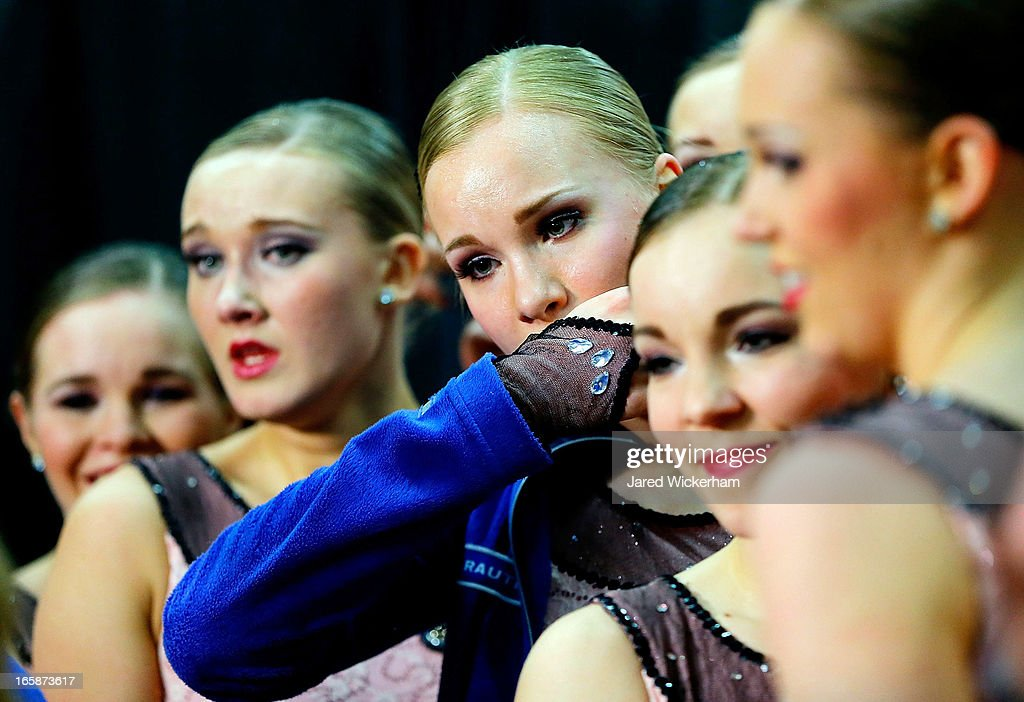 Members of Team Finland 1 react after having their first place score announced following their performance during the free skating competition of the ISU World Synchronized Skating Championships at Agganis Arena on April 6, 2013 in Boston, Massachusetts.