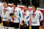 Members of team Finland receive their silver medals after losing 32 to Sweden in the final of the men's ice hockey match between Finland and Sweden...