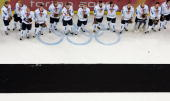 Members of team Finland stand with their silver medals after losing 32 to Sweden in the final of the men's ice hockey match between Finland and...