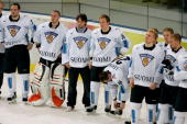 Members of team Finland wait to receive their silver medals after losing 32 to Sweden in the final of the men's ice hockey match between Finland and...