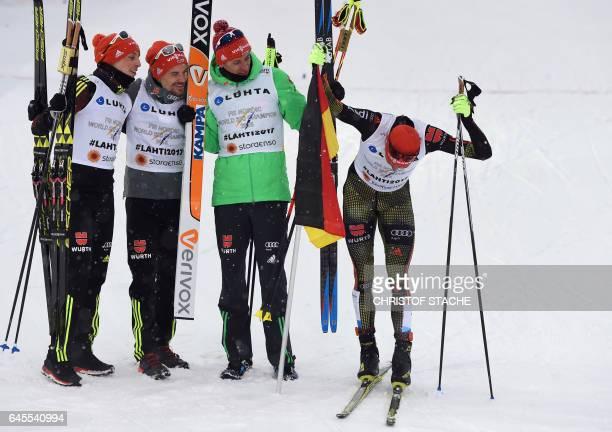 Members of Team Germany Eric Frenzel Fabian Riessle Bjorn Kircheisen and Johannes Rydzek react after winning the men's nordic combined NH Team...