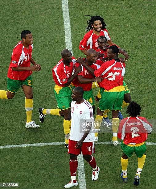 Members of team Guadeloupe celebrate after a goal by teammate Jocelyn Angloma as Canadian Ali Gerba walks off during the CONCACAF Gold Cup First...
