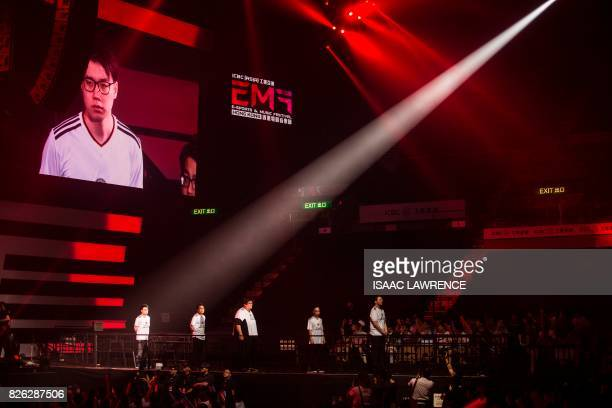 Members of team Hong Kong Taiwan and Macau are welcomed to the stage before the League of Legends gaming tournament during the eSports and Music...