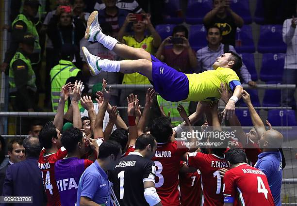 Members of team Iran send off Falcao of Brazil with several tossups after the round of 16 match between Brazil and Iran in the 2016 FIFA Futsal World...