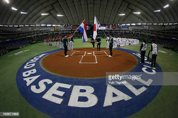 Members of Team Japan and Team Netherlands line up on the baselines during national anthems before Pool 1 Game 6 between the Netherlands and Japan in...